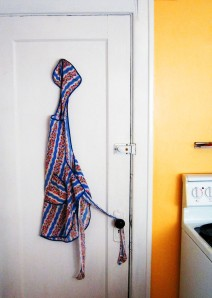 Apron hanging on a kitchen door